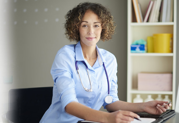 doctor with stethoscope sitting at desk